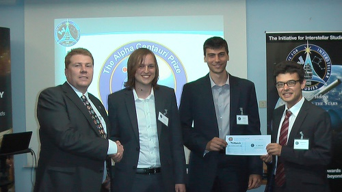 Figure 10: The team from the Technical University of Munich (TUM) is awarded the Project Dragonfly Alpha Centauri Prize (left to right: Kelvin Long (i4is), Johannes Gutsmiedl (TUM), Nikolas Perakis (TUM), Andreas Hein (i4is))